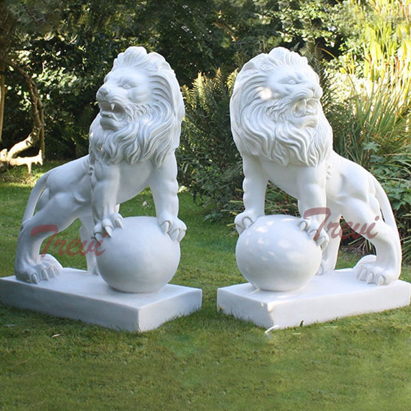 Pair of white marble decorative lion with paw on ball garden statues in front of house TMA-13