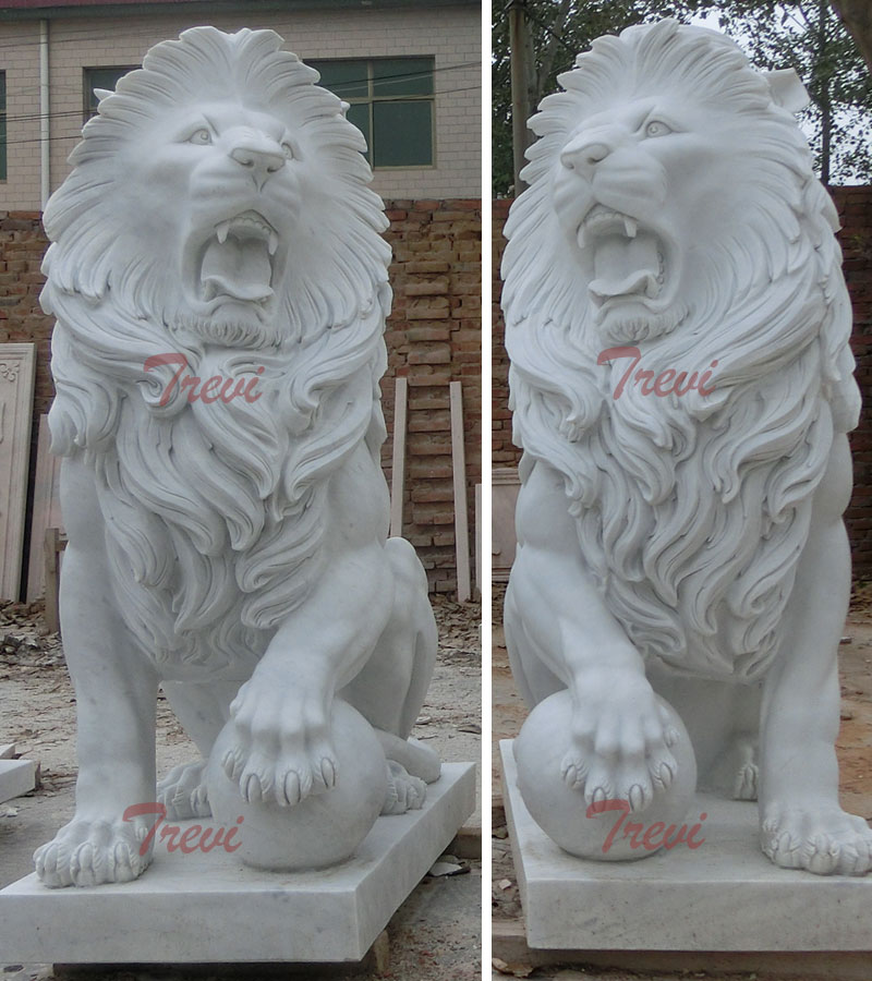 White marble sitting lion statues with paw on ball for front porch