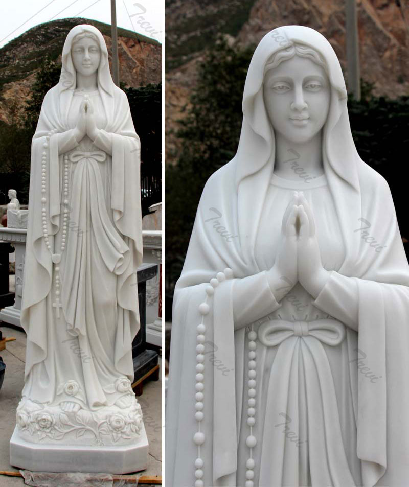 Our lady of Lourdes and st Bernadette statue