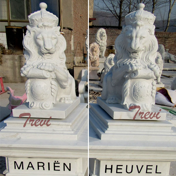 Pair of white marble king lion statue with shield and crown in front of house